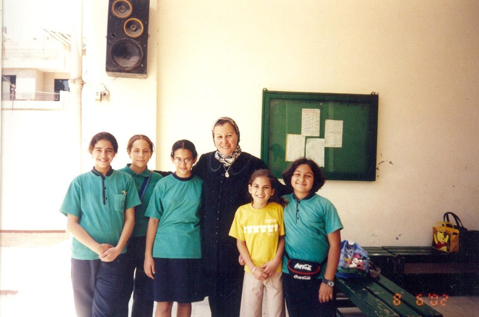 My fifth grade school friends and I posing for a picture with the principle