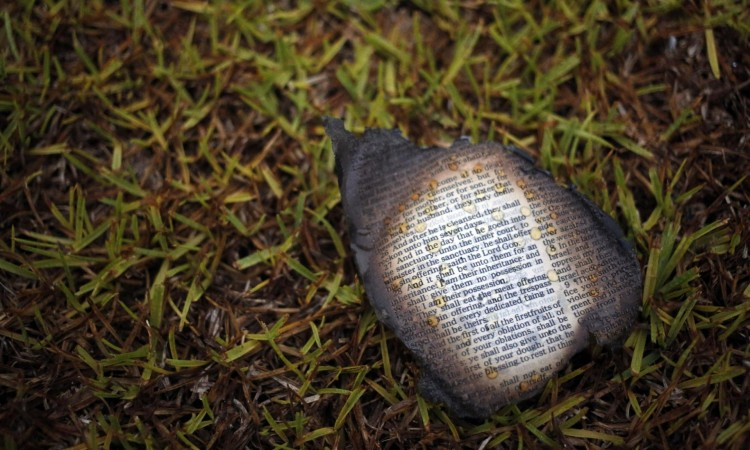 A charred bible page outside Mount Zion African Methodist Episcopal church on Wednesday in Greeleyville, South Carolina. Credit: Veasey Conway/AP