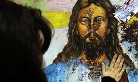 A blood-spattered image of Jesus Christ inside the the Coptic Christian Saints Church in Alexandria. Credit: Reuters