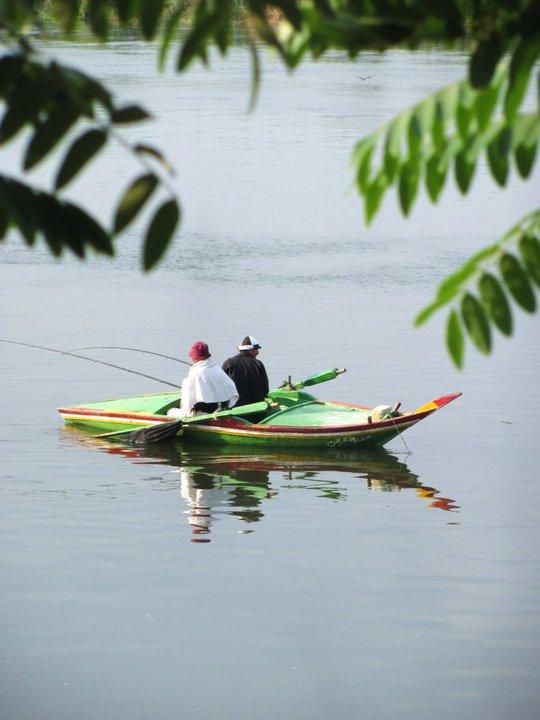 Men fishing near al-Qanater al-Khayreyya (the Delta Barrages). Credit: Enas El Masry