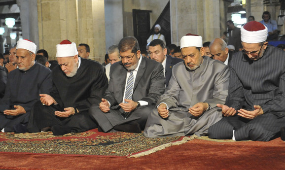 Egypt's Mohamed Morsi (C), the Grand Sheikh of Al-Azhar Ahmed El-Tayeb (R), and Egypt's Mufti Ali Gomaa (2nd L) during the Al-Gomaa prayer at Al-Azhar mosque in Cairo August 17, 2012. (Photo credit: Egyptian Presidency/Handout)
