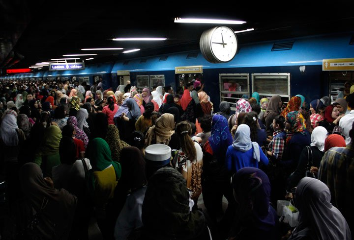 Crowds push their way through al-Sayeda Zeinab metro station in Cairo. Credit: Heba Elkholy/ AP