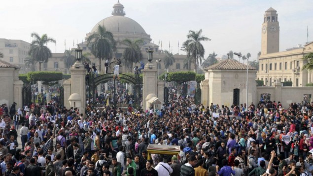 Student protesters gather outside the main gate of Cairo University, Cairo, Egypt Sunday, Dec. 1, 2013 before marching to Tahrir square. Credit: AP/Mohammed Asad