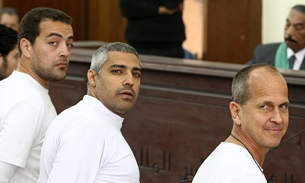 Peter Grest (right) along with Mohamed Fahmy (center) and Baher Mohamed (left) during their first trial in 2014.