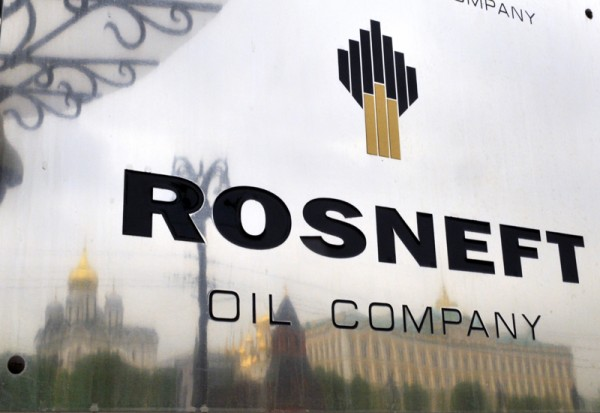 The Kremlin is reflected in the polished company plate of the state-controlled Russian oil giant Rosneft at the entrance of the headquarters in Moscow. Credit: Dmitry Kostyukov/AFP