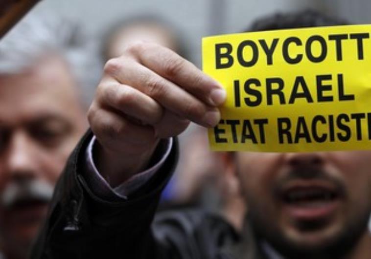 Man holds boycott Israel sign. Credit: Francois Lenoir/ Reurters