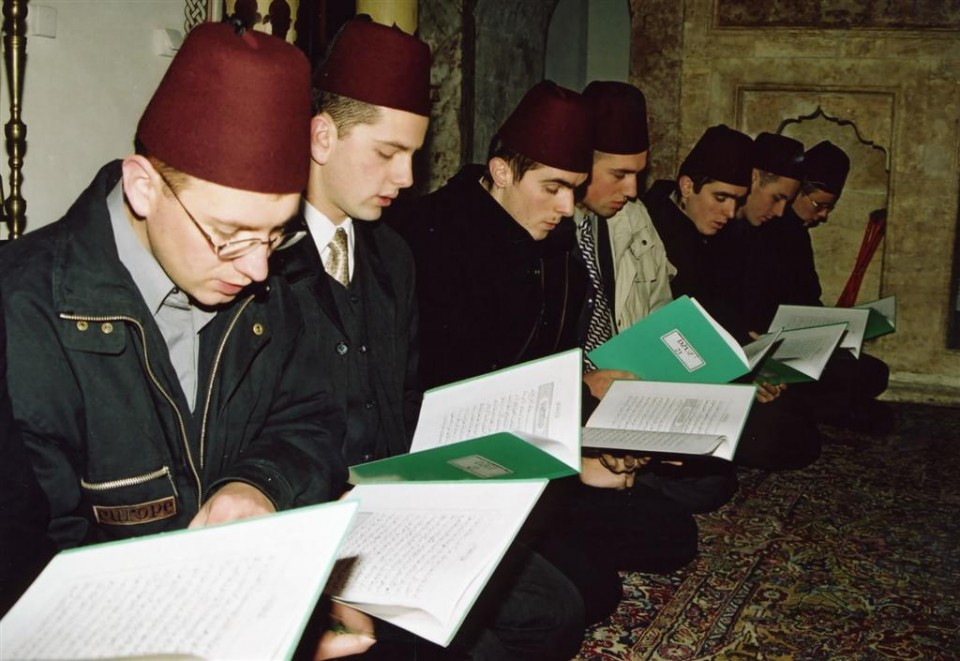 Bosnian young men studying and reciting Quran at the mosque