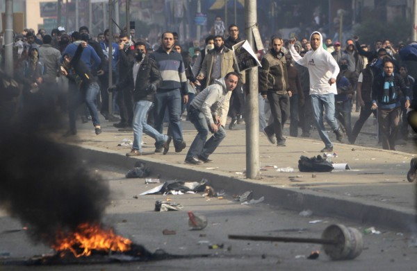 Supporters of Muslim Brotherhood and ousted President Mursi clash with riot police during clashes at Nasr City district in Cairo