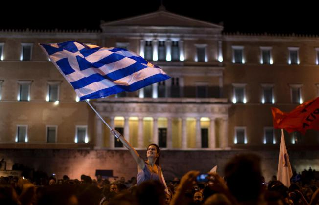 A 'No' supporter celebrates after the outcome of the referendum came out.  AP Photo/Emilio Morenatti)