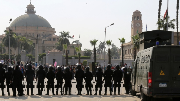 Riot police officers take positions in front of Cairo University plan a protest against former Defence Minister Field Marshal Abdel Fattah al-Sisi after he announced that he will run for presidential elections, March 30, 2014. Credit: Mohamed Abd El Ghany/Reuters