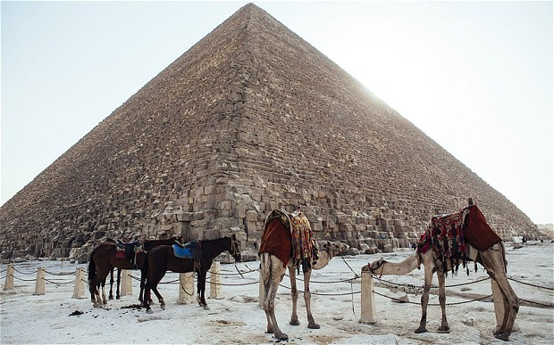 Thin snow covers the surroundings of the Giza Pyramids in Egypt after more than a century of no snow fall.