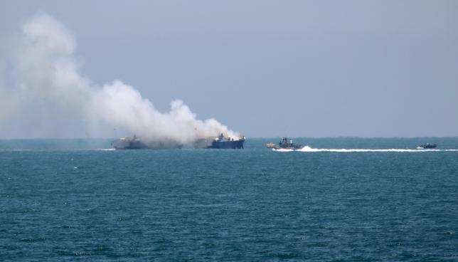 Smokes rises from an Egyptian coastguard vessel on the coast of northern Sinai, after apparently being hit by an ISIS rocket. The scene was photographed from the border of southern Gaza Strip with Egypt, on July 16, 2015. Credit: Reuters