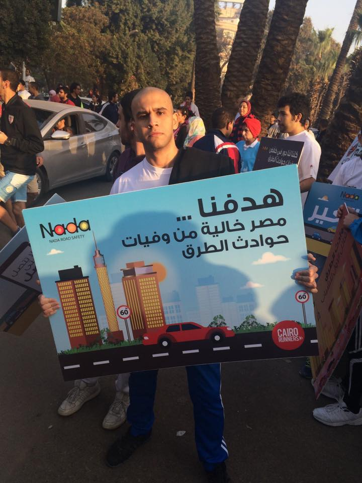 "Campaign supporters at the Nada Foundation awareness event for road safety Text reads: ""Our goal... Egypt free of road accident fatalities"""