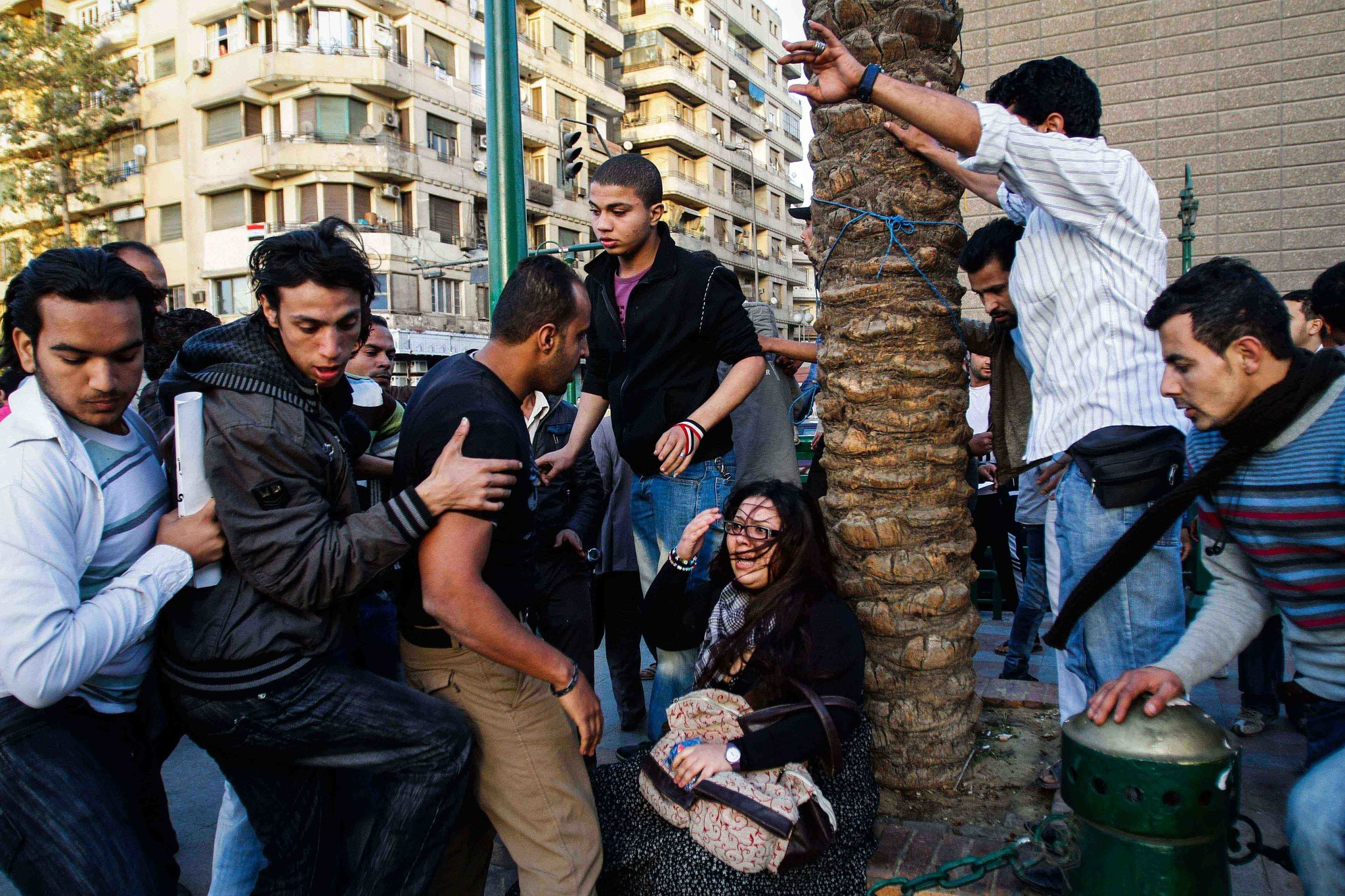 An Egyptian woman was assaulted by several men in Tahrir Square during a march for International Women's Day in March 2011. Credit: Eman Helal