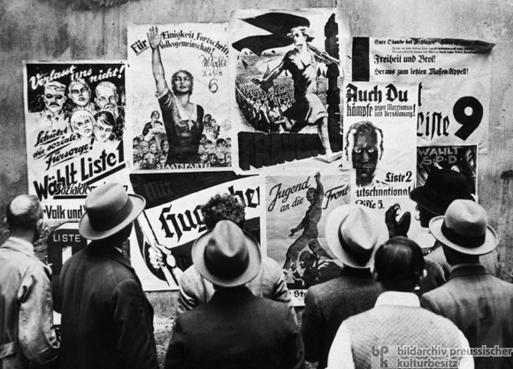 A typical campaign scene with Nazi posters on display next to the Center Party, Communists, Socialists and others.