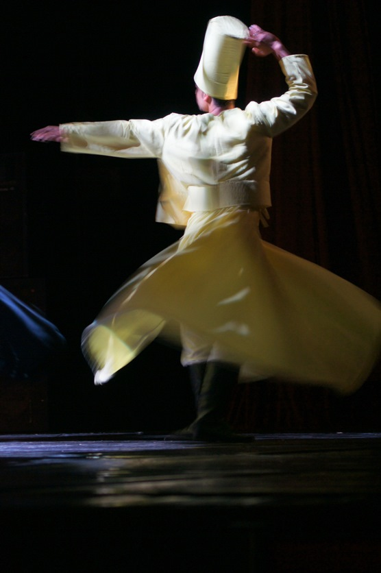 A whirling dervish clad in flowing white garments. Credit: Omneya Elnaggar