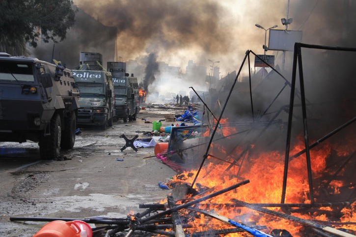 Protesters' tents burn as police moved to disperse the sit-in at Rabaa Al-Adaweya in 2013.