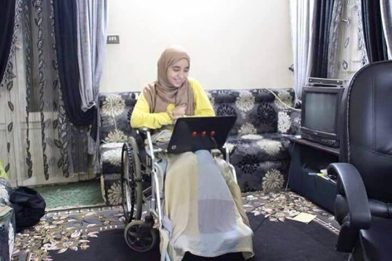 Esraa suffers leg injury due to a bullet wound that struck near her spine in 2014 as she photographed the anniversary of the January 25th revolution.