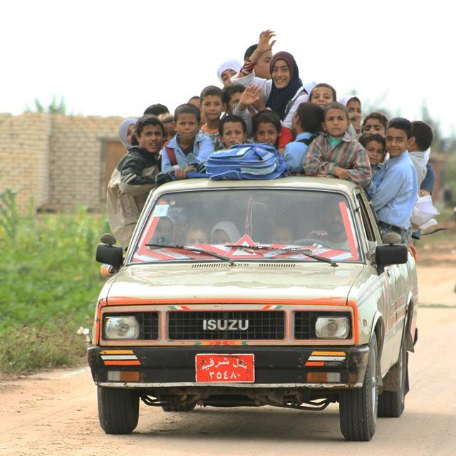 Tens of children returning from school on a pick up truck at a remote village in Qantra Sharq, North Sinai. Photo by Mohamed Ali Eddin