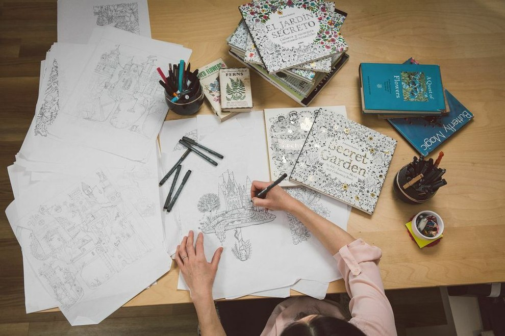 Johanna Basfor, 'Queen of Coloring', at work while designing her color books. Courtesy of Johanna Basford and Laurence King
