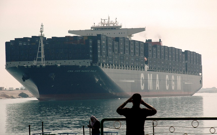 The largest and newest container ship in the world, the CMA CGM Marco Polo, sails through the Suez Canal ahead of the opening ceremony. Credit: AFP