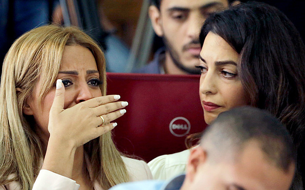 Marwa Fahmy, Mohamed Fadel Fahmy's wife, upon hearing the verdict which sentenced her husband to three years in prison. Photo: Amr Nabil/AP