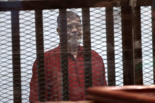 Former President Mohamed Mursi in his first appearance in a red prison uniform during a court hearing, on June 21, 2015/ASWAT MASRIYA