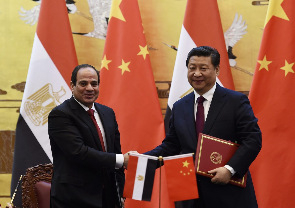 Egypt's President Sisi shakes hands with Chinese President Xi during a signing ceremony in the Great Hall of the People in Beijing