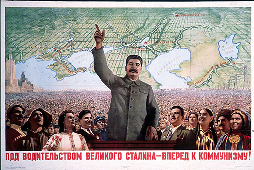 "Soviet propaganda poster reads: ""Under the Leadership of the Great Stalin - Forward to Communism"""