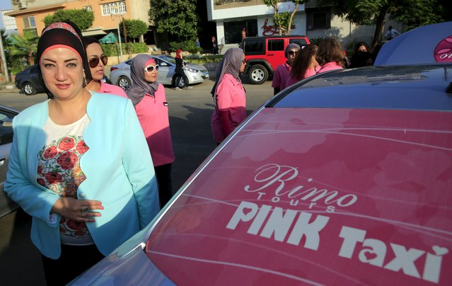 Reem Fawzy, the director of the Pink Taxi company stands in a parking lot with women drivers in Cairo. Credit: Amr Abdallah Dalsh/ Reuters