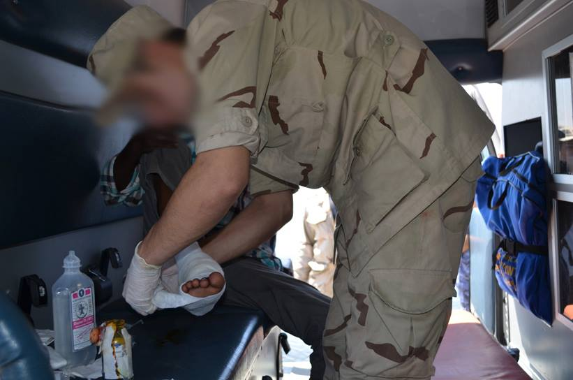 A refugee is treated for his wounds. Credit: Military Spokesman