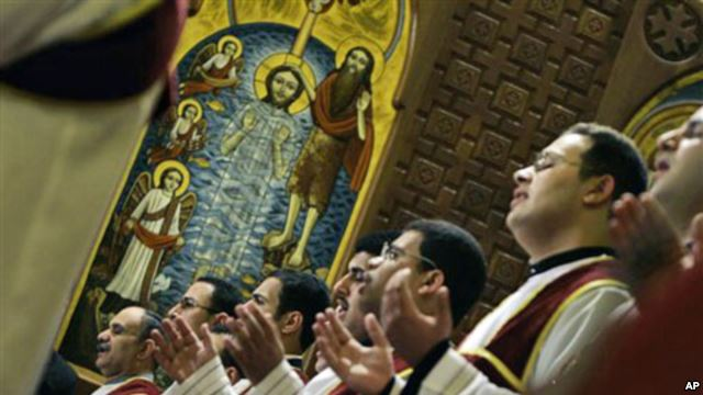 Egyptian Coptic deacons pray during Christmas mass at Saint Mark Coptic Orthodox Cathedral in Cairo. Credit: AP