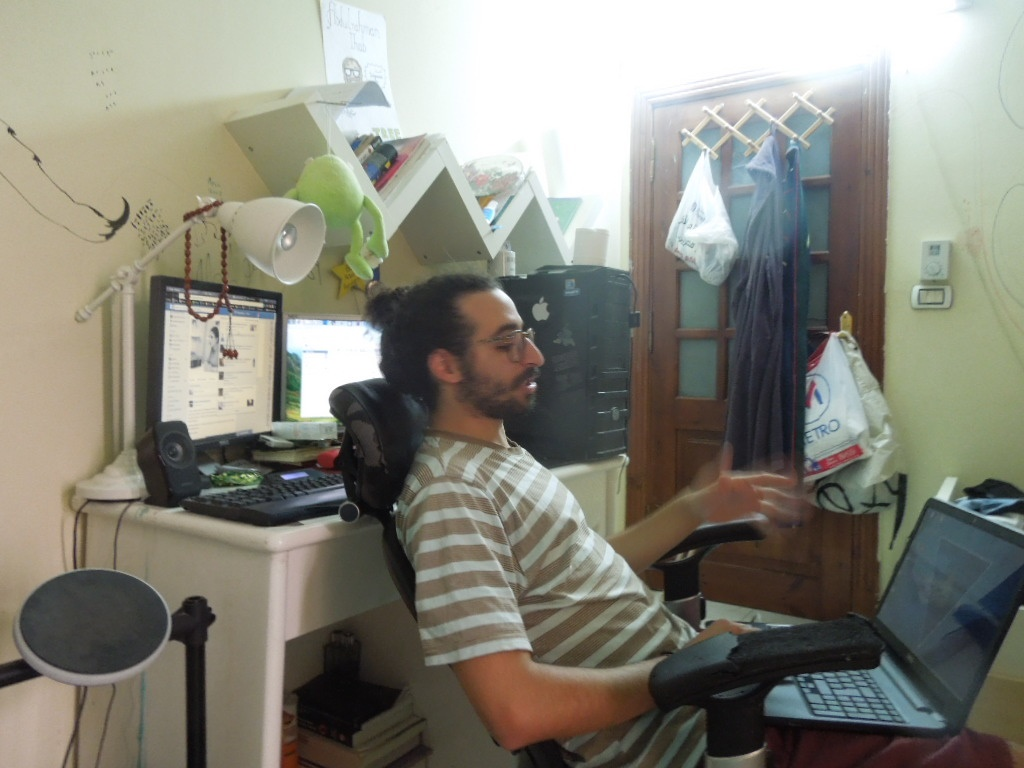 Abdoul in his room, where most of the magic takes place