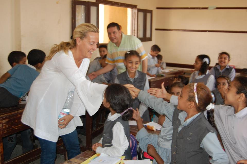 Flavia Shaw-Jackson, founder of FACE pays a visit to children at a school in Obour, Cairo.