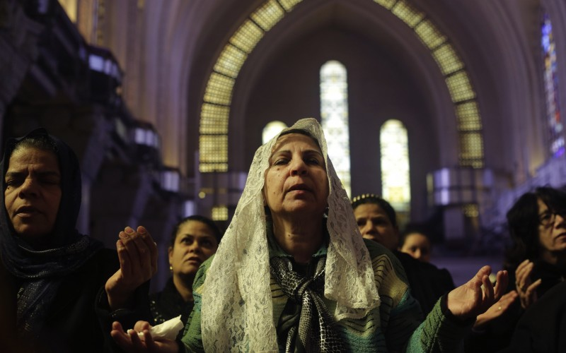 Women pray during a mass lead by Pope Tawadros II. Credit: PA
