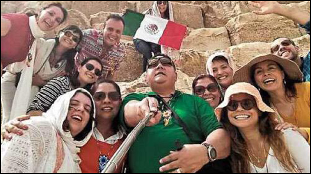 Selfie of the Mexican tourists at what appears to be the Pyramids.
