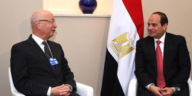 World Economic Forum Founder and Executive Chairman Klaus Schwab (left) with Egyptian President Abdel Fattah El Sisi (right). PHOTO: Youm7