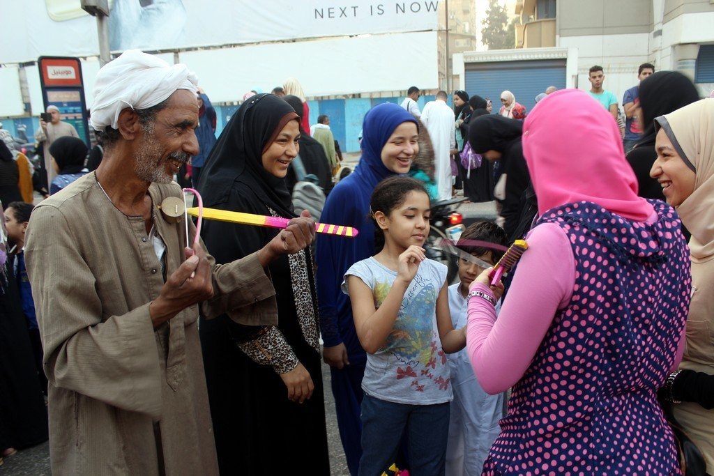 Egyptians celebrate Eid Al-Adha in the street after early morning prayers, September 24, 2015. PHOTO: Ahmed Hamed, Aswat Masriya.