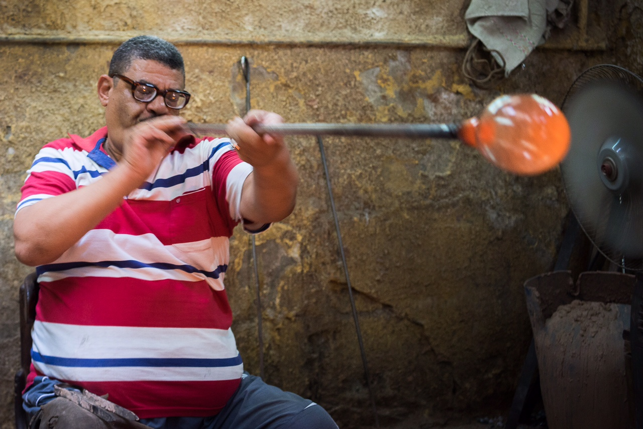 Hassan Ahmed Ali, popular as Hassan Hodhod, one of Egypt's few remaining glassblowers. Credit: Dina Mansour