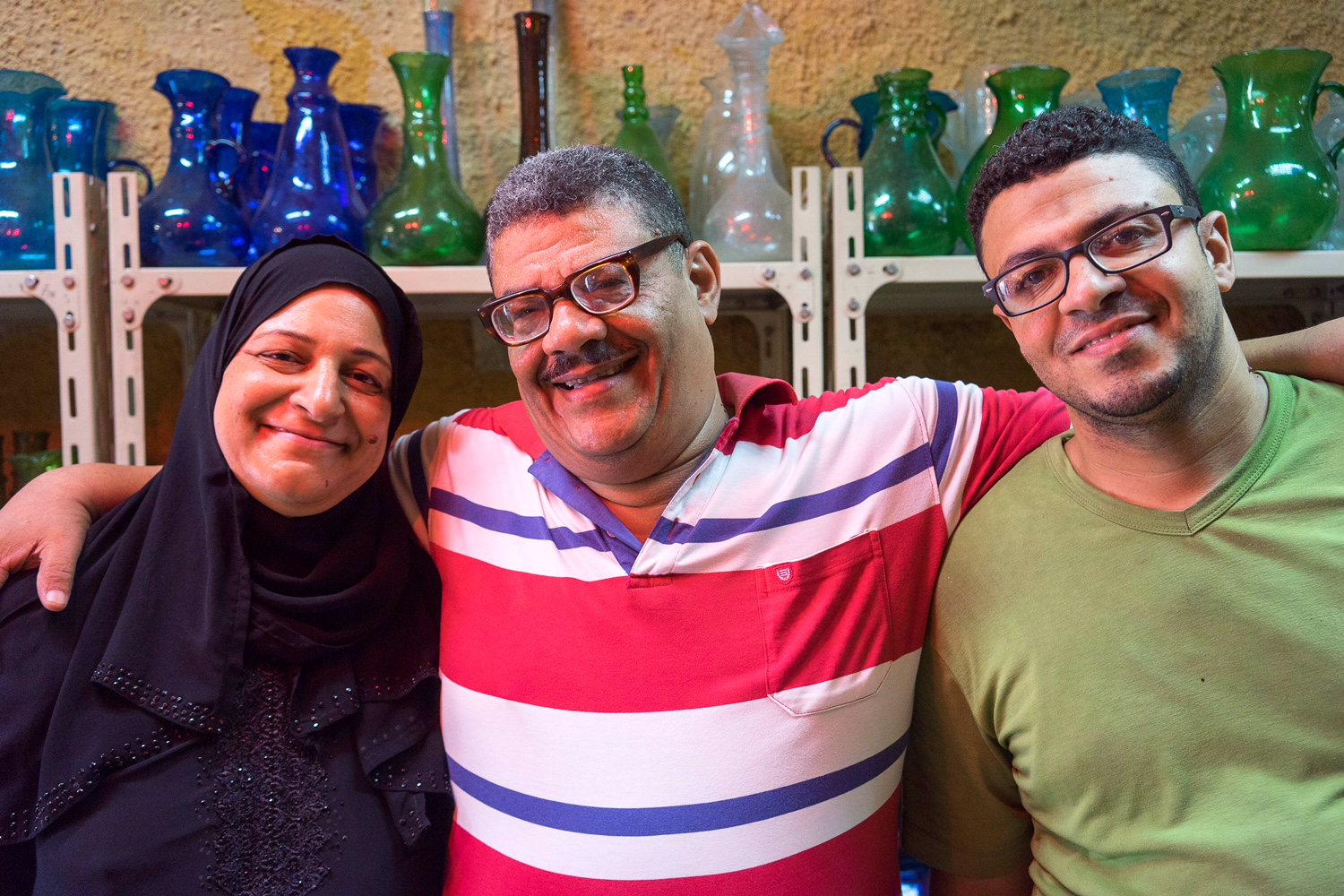 Hassan's wife (left), Hassan (middle), Hassan's son Kamal (right). Besides Hassan and Ahmed, Hodhod's family also take part in glassblowing.
