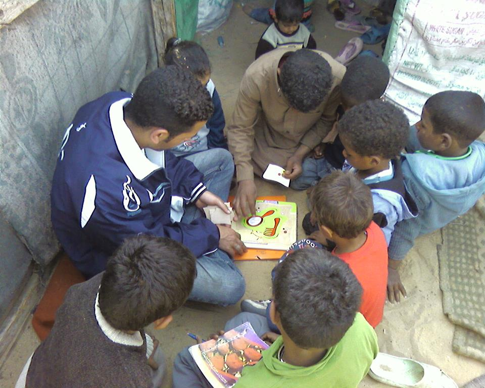 FACE team member engaging with children on the street. Courtesy of Flavia