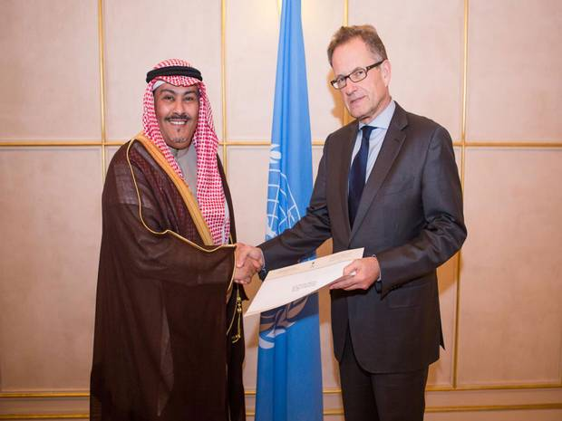 Ambassador Faisal bin Hassan Trad (left) presenting his credentials to Mr. Michael Møller(right), the Acting Director-General of the United Nations Office at Geneva. January 7th, 2014. PHOTO: The Independent.