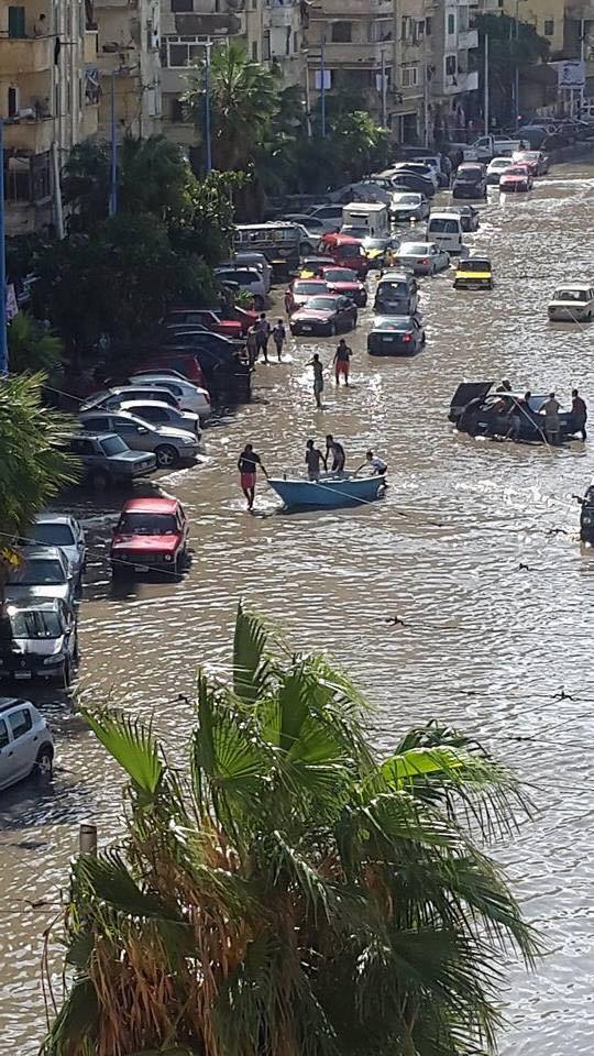 On the flooded streets, fishing boats came in more handy than cars and motor bikes.