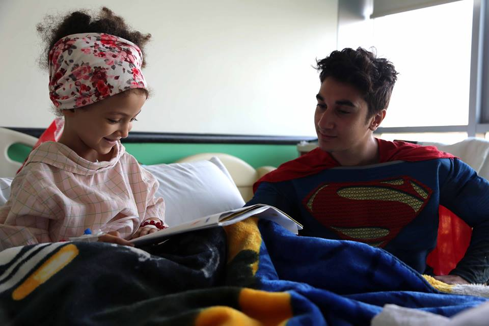 Mohannad spending bringing joy to the children at 57357 during the superheroes' visit to the hospital. Source: 57357 Facebook page
