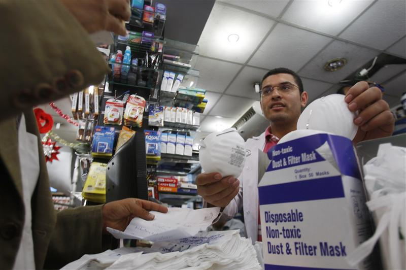 A doctor buys face masks at a pharmacy in Cairo June 9, 2009. Credit: Amr Abdallah Dals/ Reuters