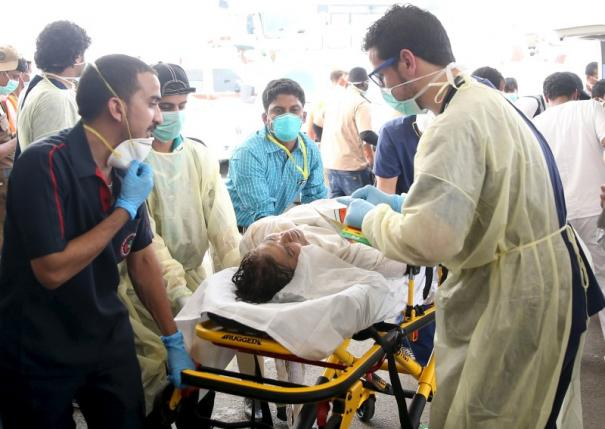Medical personnel tend to a wounded pilgrim following a crush caused by large numbers of people pushing at Mina, outside the Muslim holy city of Mecca September 24, 2015.   Credit: Stringer/ Reuters