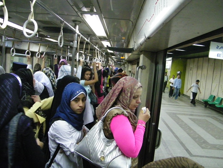Some metro carts are for women only throughout the entire day (marked with red banners), while others are women-only carts from 9 am till 9 pm (marked with green banners). Source: The Daily News Egypt