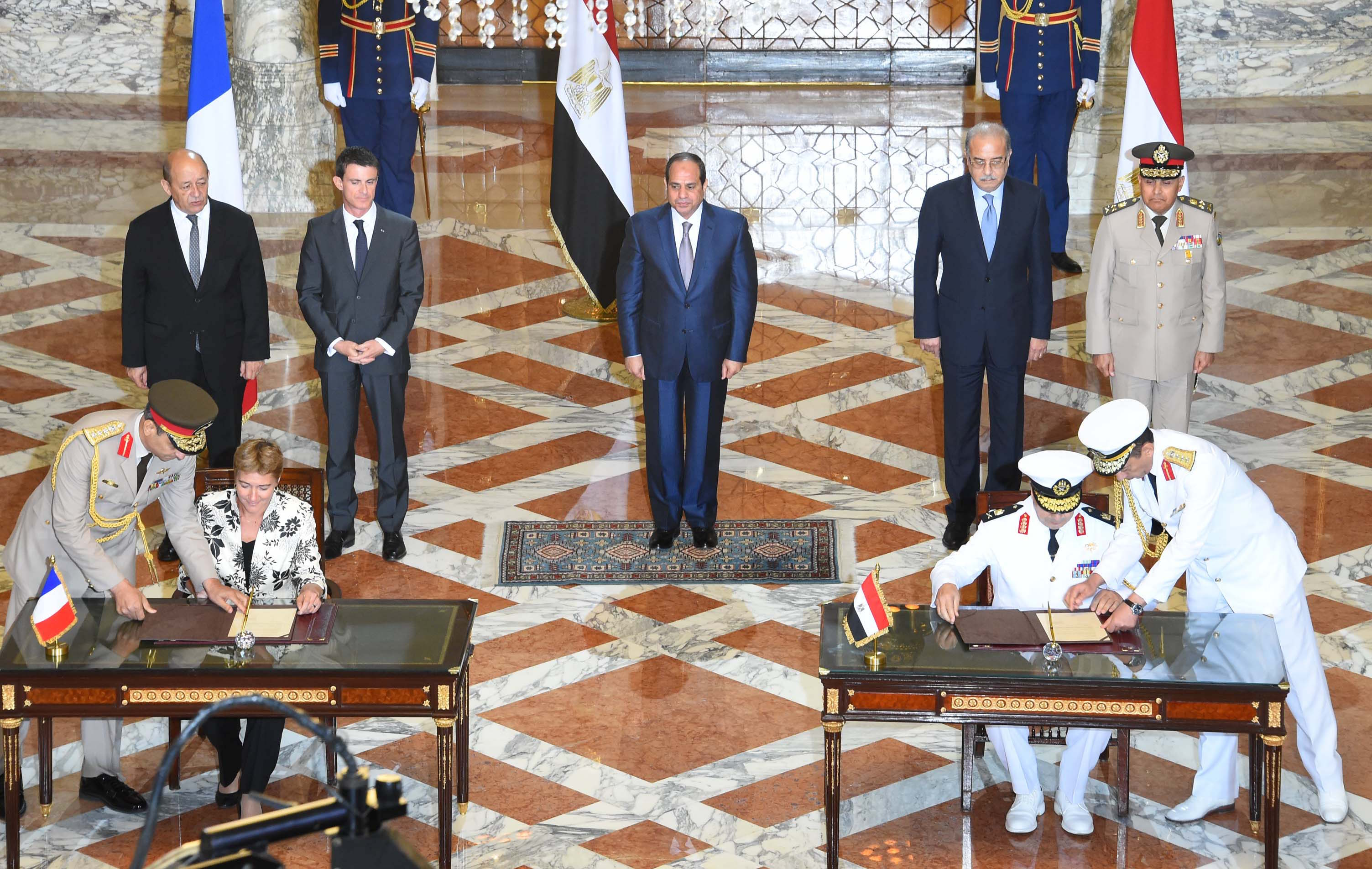 Egyptian President Abdel Fattah El-Sisi with the French and Egyptian Prime Ministers and Ministers of Defence at the deal-signing ceremony. PHOTO: Egypt's State Information Service