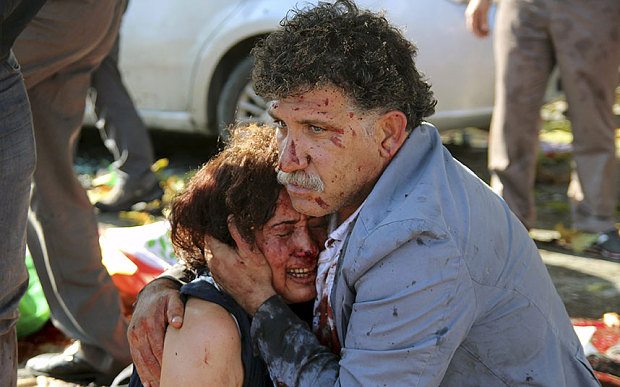 An injured man holds an injured woman after explosions targeted a peace rally in Ankara, Turkey (REUTERS/Tumay Berkin)