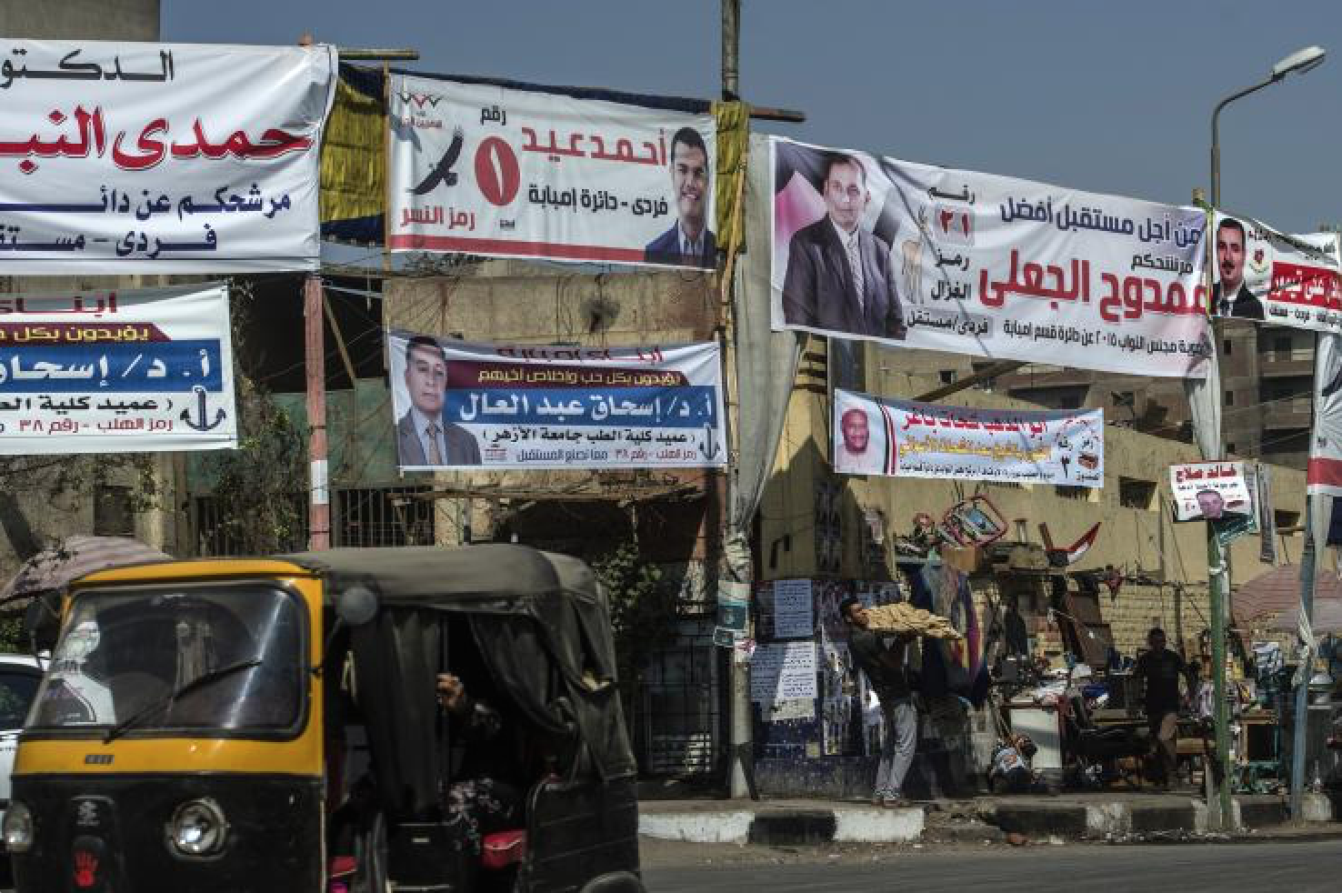 Portraits of candidates for Egypt's long awaited parliamentary elections hang in the Imbaba district of Cairo, on Oct. 15, 2015. Getty Images/AFP/KHALED DESOUKI